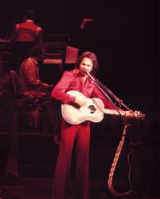 Neil Diamond vroeger in rood pak