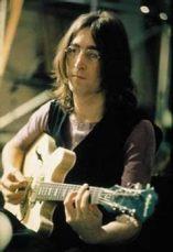 John Lennon met gitaar
